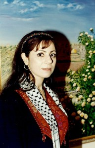"Marcelle Mansour at the Australian Museum, Images of Wisdom Art Exhibition, in front of her painting ""Jerusalem in Search of Peace"" ©1997"