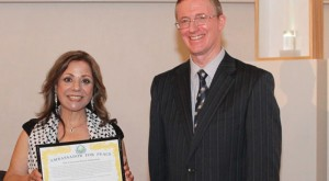 Marcelle Mansour receives the Ambassador for Peace Award from Gregory Stone President of UPF