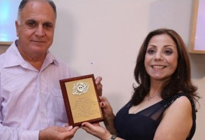 Marcelle Mansour receives an Art Award by Mr Tawfik Awad the the President of A. P. C.