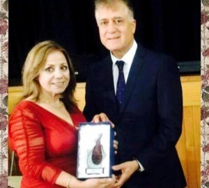 Marcelle Mansour receives Arts & Creativity Award by Dr M Alameddine from AACC on International Women Day 2016